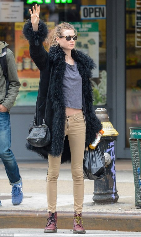 StyleChi-Behati-Prinsloo-Street-Style-Best-Looks-Victoria's-Secret-Angel-Black-Shaggy-Fur-Trim-Suede-Coat-Beige-Skinny-Jeans-Red-Doc-Martens-Sunglasses
